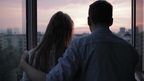 Young Couple On The Balcony At Sunset stock footage