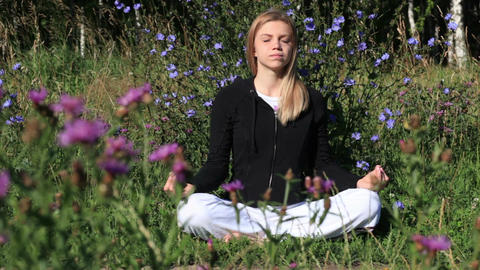 Woman meditating in the city park Stock Video Footage