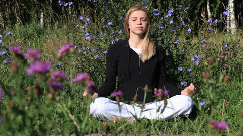 Woman meditating in the city park Footage