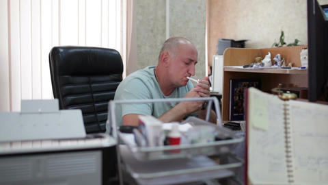 Businessman smoking in the office Stock Video Footage