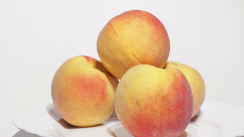 Juicy peaches on white background Stock Video Footage