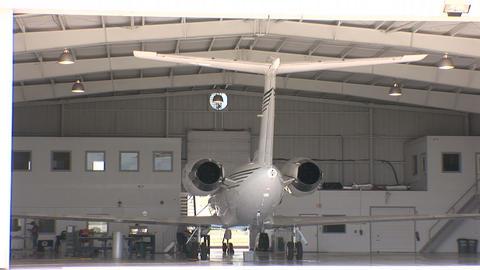 Plane in hanger Stock Video Footage
