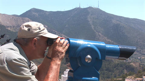 Man looks through telescope Footage