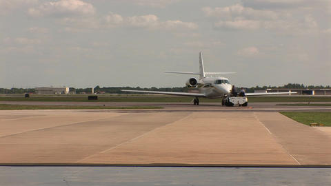Plane being towed Stock Video Footage