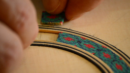 Luthier decorates handmade guitar extreme close up Footage