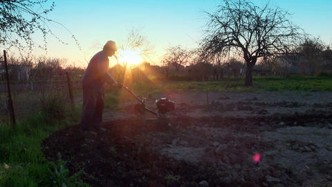 Working Man With Motor Cultivator stock footage