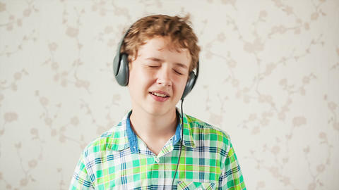 The boy listens to music Stock Video Footage
