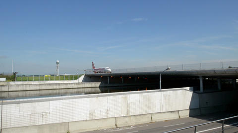 Easy Jet airplane on taxiway on bridge over street Stock Video Footage