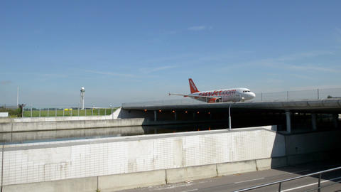 Easy Jet airplane on taxiway on bridge over street Footage