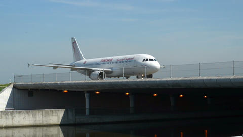 Tunisair airplane on taxiway bridge 11033 Stock Video Footage