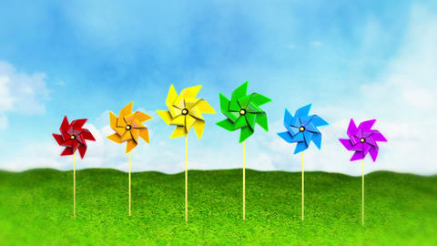 Rainbow Colored Spinning Pinwheels on Grass Stock Video Footage