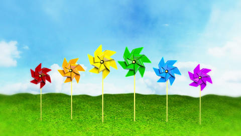 Rainbow Colored Spinning Pinwheels On Grass stock footage