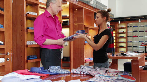 Customer speaking to sales manager in fashion stor Footage