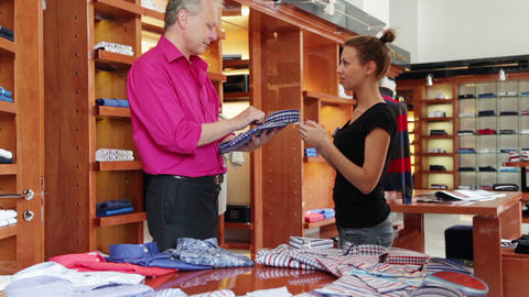 Customer speaking to sales manager in fashion stor Stock Video Footage