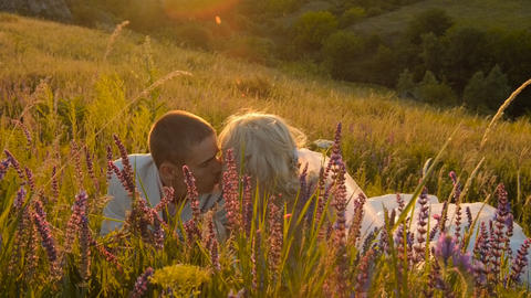 Newly Married Couple Kissing In Nature stock footage