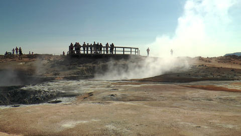 tourists watching fumaroles and mud pools in icela Stock Video Footage
