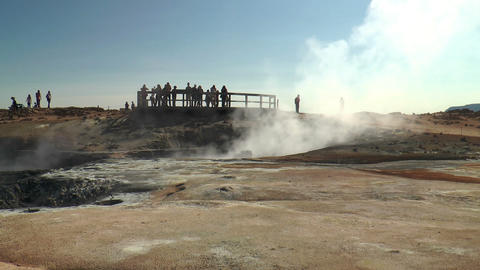 tourists watching fumaroles and mud pools in icela Footage