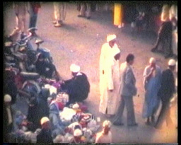 People in a typical zoco Morrocan 8mm vintage Footage
