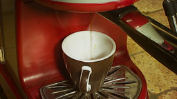 Coffee cup pouring from machine 1 Stock Video Footage