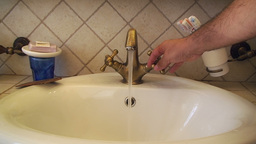 Faucet water tap open close hand Stock Video Footage