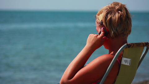 Woman Talking on the Phone at the Beach 2 Footage