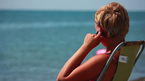 Woman Talking on the Phone at the Beach 2 Stock Video Footage