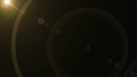 Lens Flares crossing gold slope Stock Video Footage