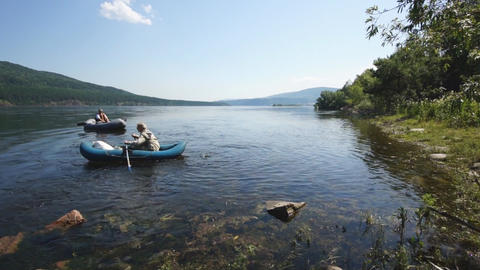 River Yenisei 08 with fishing boats sailing away Stock Video Footage