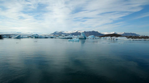 A vast blue glacier lagoon in the interior of Icel Footage