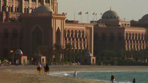 People walk near a mosque in Abu Dhabi, United Ara Stock Video Footage