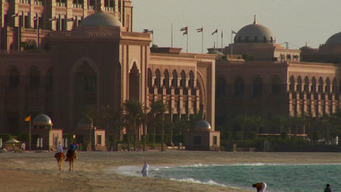 People walk near a mosque in Abu Dhabi, United Ara Footage