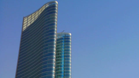 Fast tilt up to high rises in Abu Dhabi in the Uni Stock Video Footage