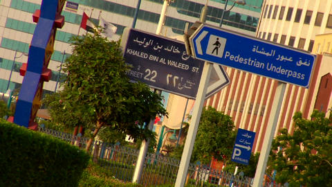 Signs in English and Arabic line a highway in the Stock Video Footage