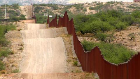 The U.S. Mexico border fence becomes a focal point Stock Video Footage
