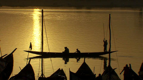 Boats are rowed on the Niger River in beautiful go Footage