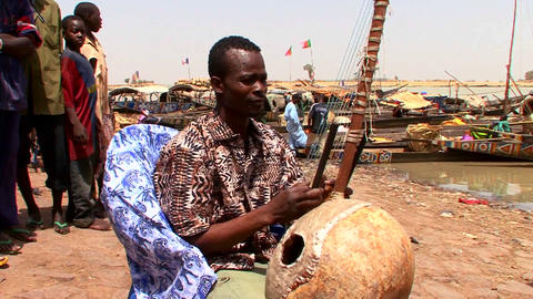 A man plays a beautiful stringed instrument in Mal Stock Video Footage