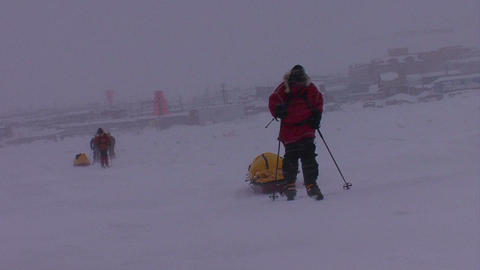 An Arctic expedition moves across frozen tundra on Stock Video Footage