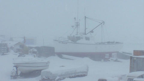 A frozen fishing boat sits in a port in the Arctic Footage