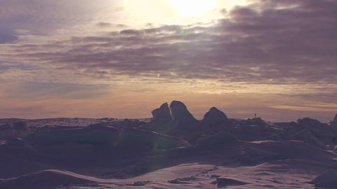 Sunset behind a frozen tundra scene in the Arctic Stock Video Footage
