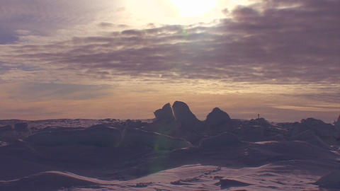 Sunset behind a frozen tundra scene in the Arctic Footage