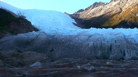 A glacier extends down a hillside Footage