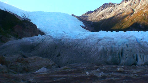 A glacier extends down a hillside Stock Video Footage