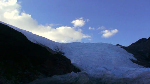 A large glacier spills over a cliff Stock Video Footage