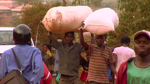 People carry goods on their heads in an African vi Footage