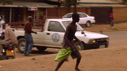 An African man does a bizarre stunt by running up Stock Video Footage