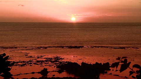 A beautiful red and orange sunset behind the ocean Stock Video Footage