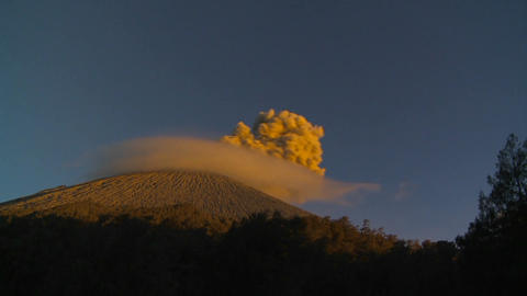 A large volcano erupts in a cloud of smoke and ash Stock Video Footage