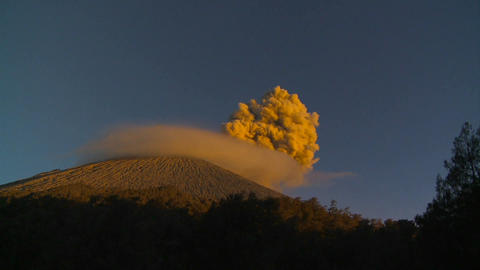 A large volcano erupts in a cloud of smoke and ash Footage
