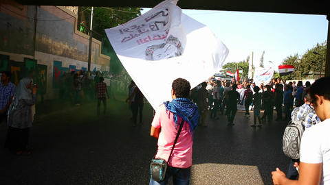 Demonstrators wave homemade banners in Cairo, Egyp Stock Video Footage