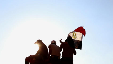 Protestors wave the Egyptian flag in Cairo, Egypt Stock Video Footage